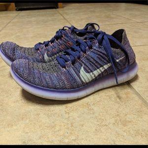 New purple Nike knit shoes.